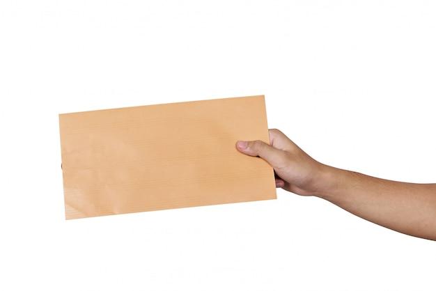 Mains tenant une enveloppe brune Photo Premium