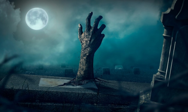 Mains zombies se levant dans la nuit sombre halloween. Photo Premium