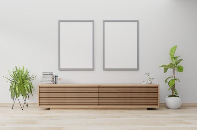 Maquette d'affiches dans le salon moderne avec armoire et plante Photo Premium