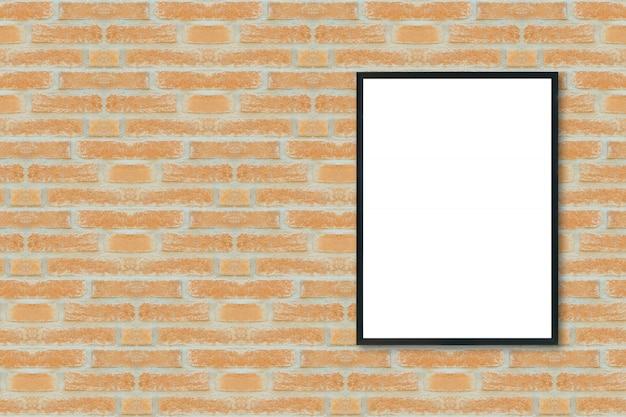 Maquette cadre photo affiche vierge sur le mur de briques. Photo Premium