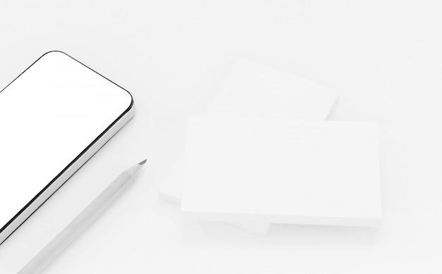 Maquette de cartes de visite avec téléphone intelligent sur fond de papier texturé blanc Photo Premium