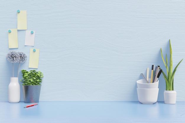 Maquette d'espace de travail pour ordinateur portable sur le bureau et pour travailler avec une décoration sur le mur arrière bleu Photo Premium