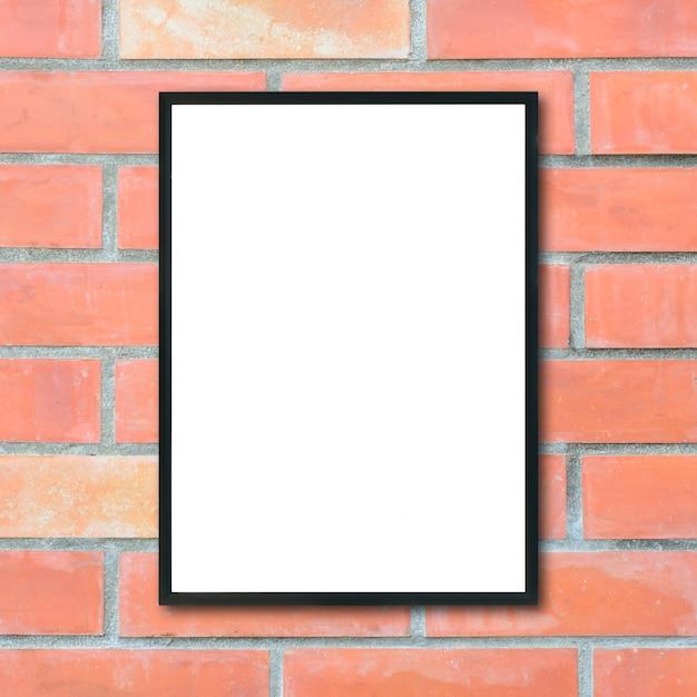 Maquette vide cadre photo affiche sur le mur de briques. Photo gratuit