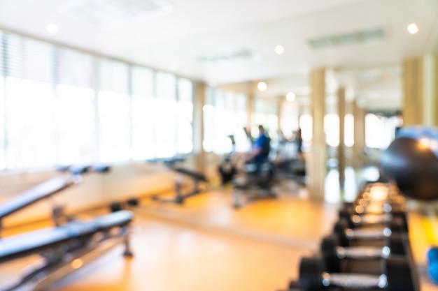 Matériel de fitness abstrait flou et défocalisation à l'intérieur de la salle de sport Photo gratuit