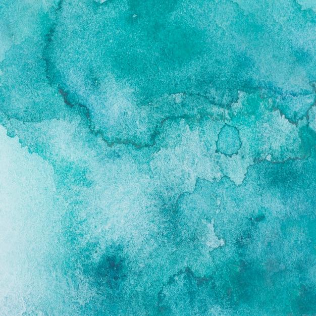 Mélange aquamarine de peintures sur papier Photo gratuit