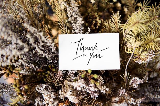 Merci carte avec des fleurs d'hiver Photo gratuit