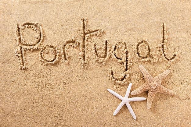Message manuscrit sur le sable de la plage, portugal algarve Photo Premium