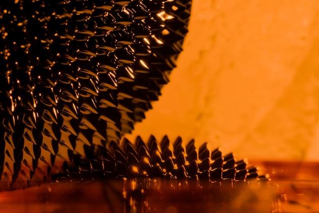 Métal liquide ferromagnétique orange avec espace de copie Photo gratuit