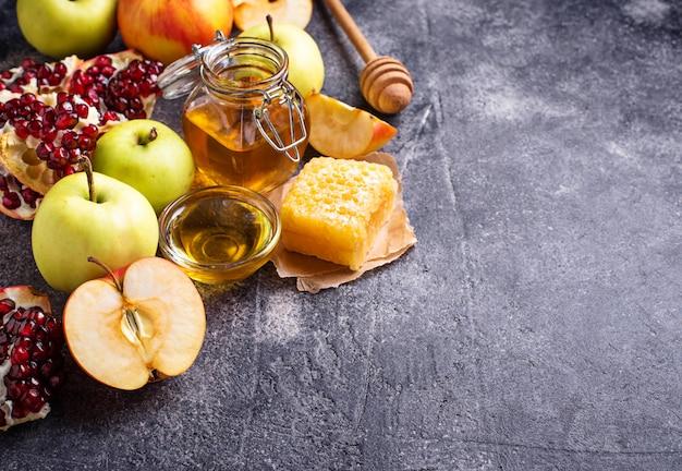 Miel, pomme et grenade pour rosh hashana Photo Premium