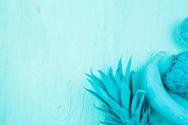 Mise en page de fruits tropicaux bleus Photo gratuit