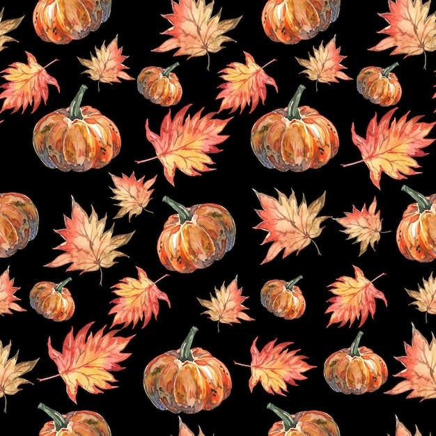 Modèle d'aquarelle halloween de feuilles d'automne et de citrouilles sur fond noir Photo Premium