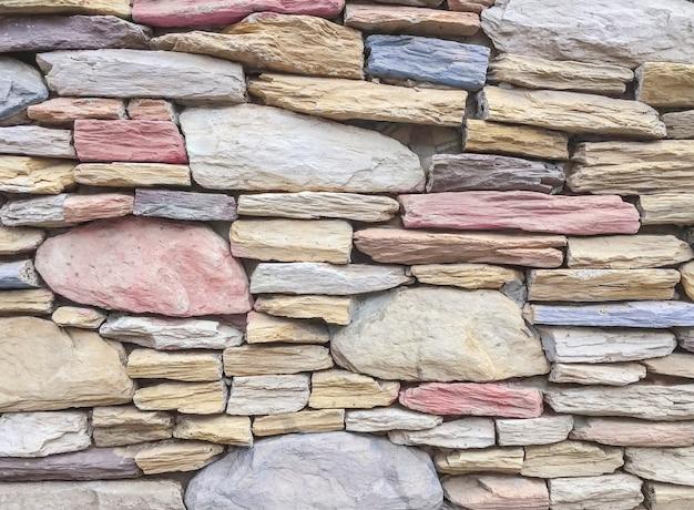 Modèle de brique de surface agrandi au vieux fond de texture de mur de brique en pierre de couleur Photo Premium