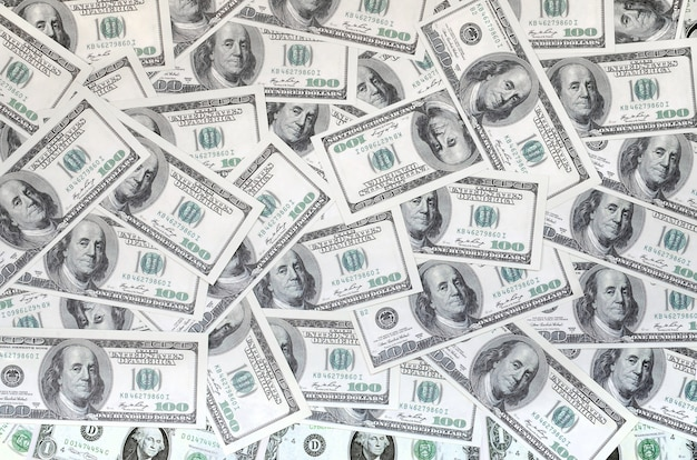 Un modèle de nombreux billets d'un dollar. image de fond Photo Premium
