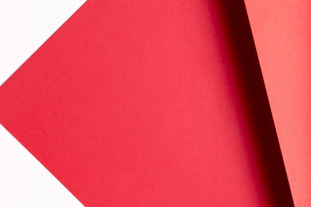 Modèle de nuances rouges à plat avec espace de copie Photo gratuit