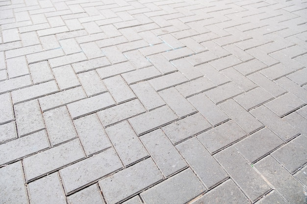 Modèle de plancher de bloc de pavé en béton pour le fond Photo Premium