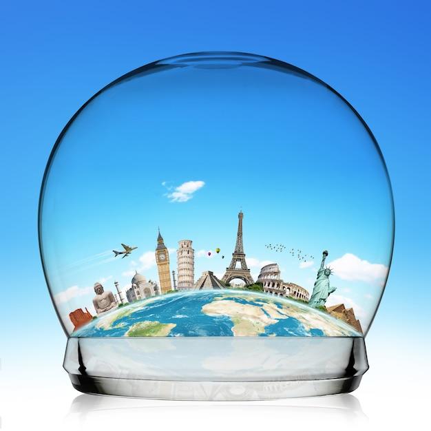 Monuments du monde dans une boule de neige Photo Premium