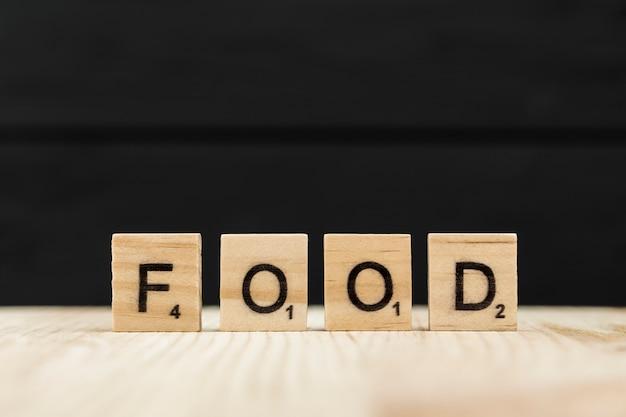 Le Mot Nourriture épelé Avec Des Lettres En Bois Photo gratuit
