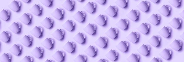Motif de tasses sur fond de couleur violette tendance. Photo Premium