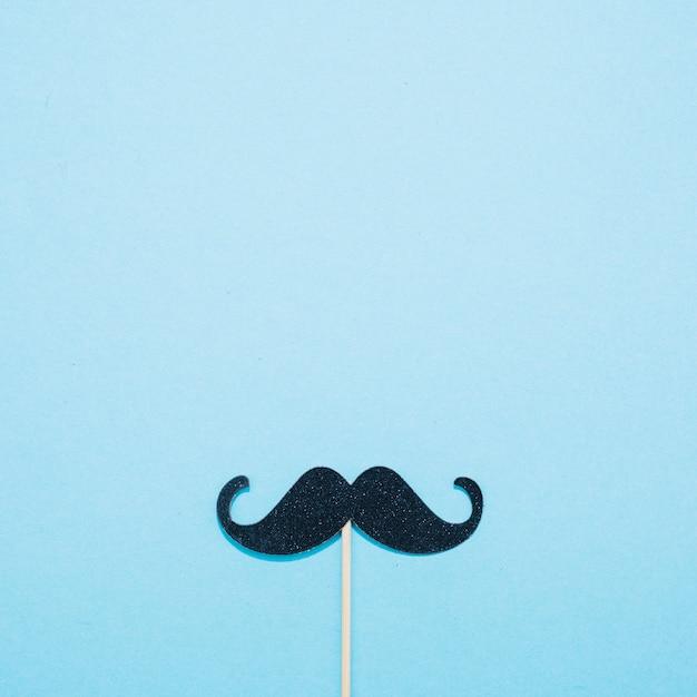 Moustache décorative sur baguette Photo gratuit