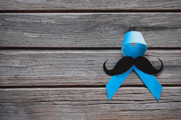 Moustache Avec Ruban Bleu Sur Bois. Photo Premium