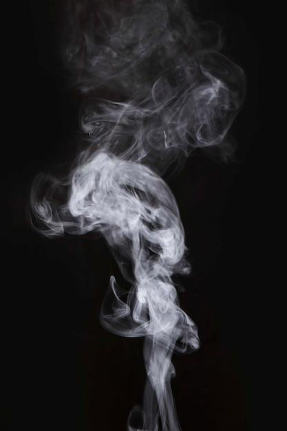 Mouvement de fumée blanche sur fond noir   Télécharger des Photos gratuitement