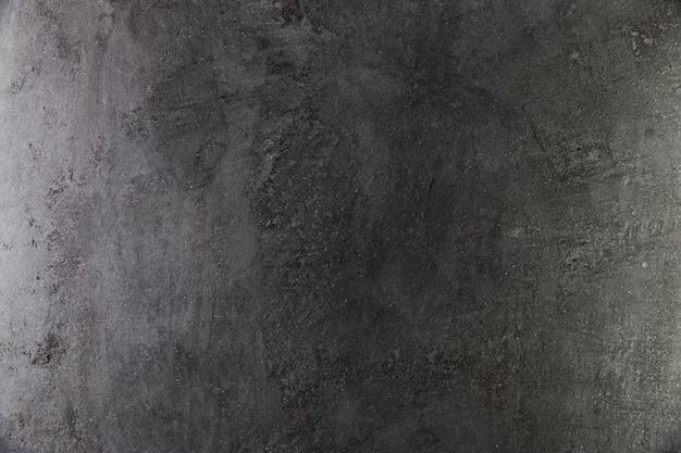 Mur En Béton Foncé Avec Surface Grossière Photo gratuit