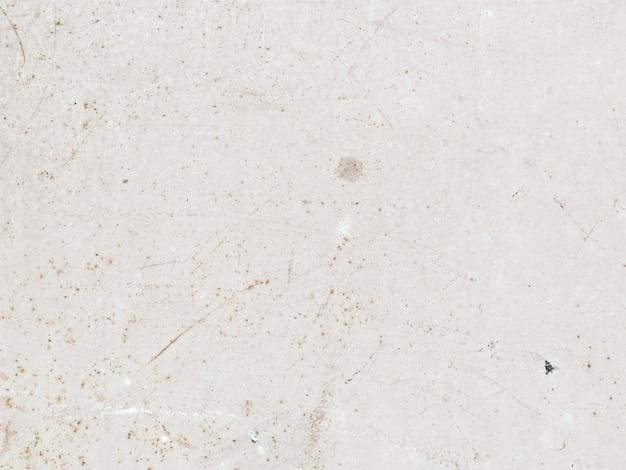 Mur de béton tacheté blanc texturé Photo gratuit