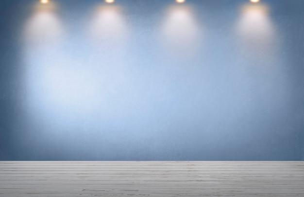 Mur bleu avec une rangée de projecteurs dans une pièce vide Photo gratuit