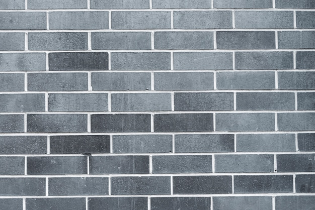 Mur de brique gris Photo gratuit