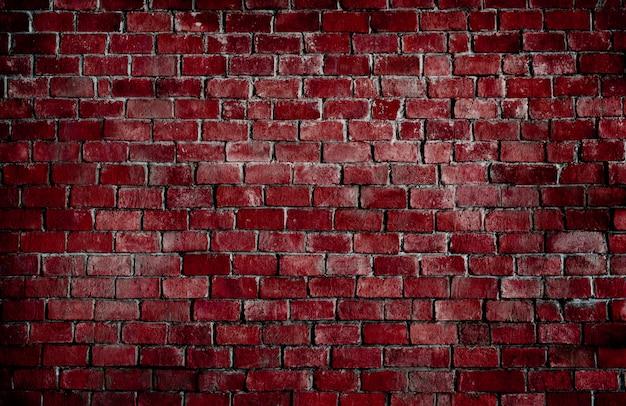 Mur de brique rouge texturé Photo gratuit
