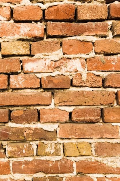 Mur De Briques Avec Du Béton Photo gratuit