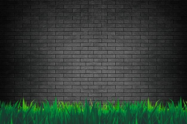 Mur de briques et fond d'herbe ou de papier peint Photo Premium