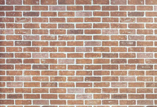 Mur de briques orange clair avec espace de copie. Photo Premium