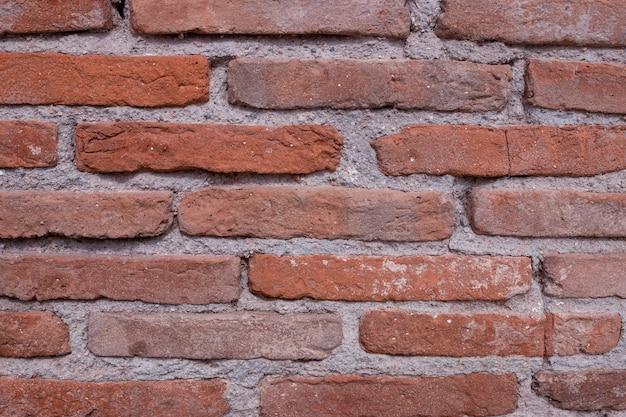 Mur de briques rouges vintage. fond grunge Photo Premium