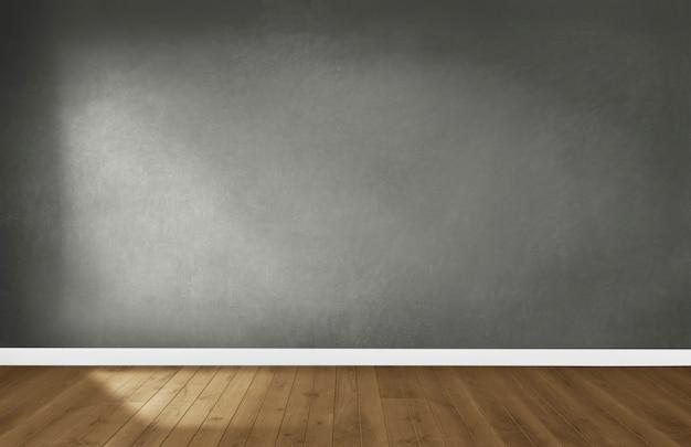 Mur gris dans une pièce vide avec un plancher en bois Photo gratuit