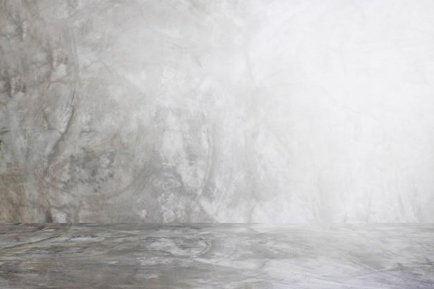 Mur gris de fond de studio de ciment pour le produit de présentation Photo Premium