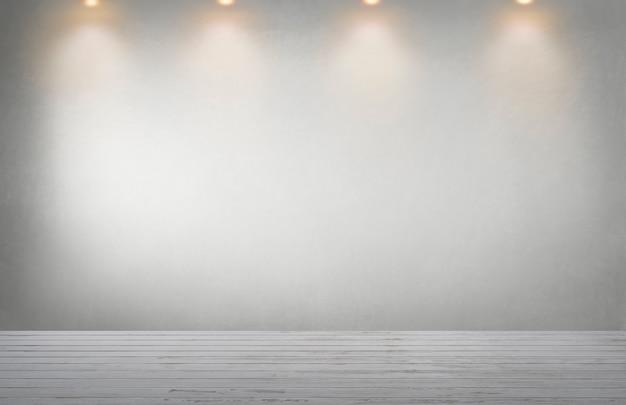 Mur gris avec une rangée de projecteurs dans une pièce vide Photo Premium