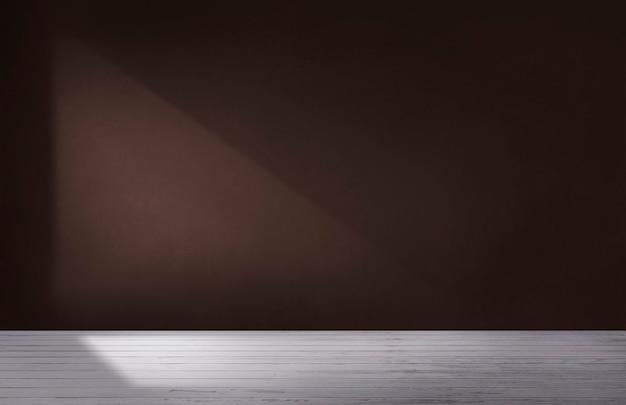 Mur marron foncé dans une pièce vide avec sol en béton Photo gratuit