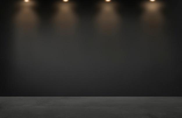 Mur noir avec une rangée de projecteurs dans une pièce vide Photo Premium