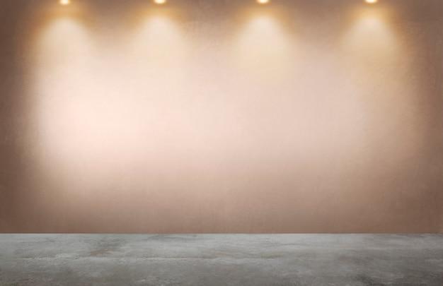 Mur orange fané avec une rangée de projecteurs dans une pièce vide Photo Premium
