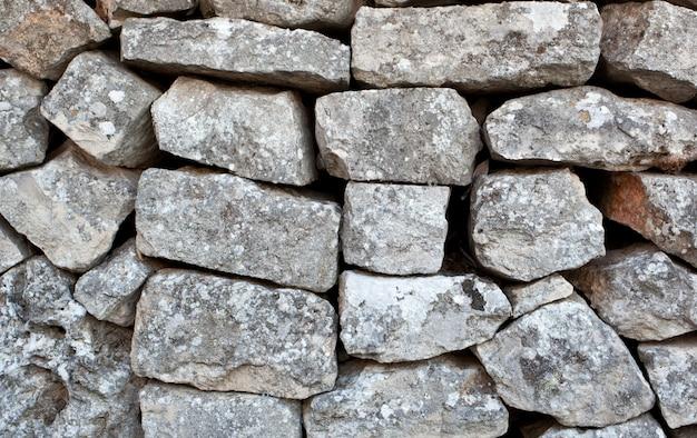 Mur de pierre d'un trullo à alberobello Photo Premium