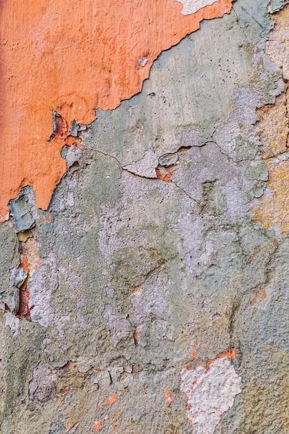 Mur texturé en béton avec peinture écaillée. Photo Premium