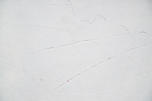 Mur texturé peint en blanc et vide Photo gratuit