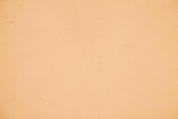 Mur texturé peint en orange Photo gratuit