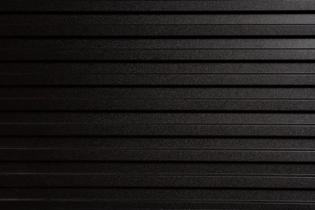 Mur en tôle grise. zinc-like utilisé comme une clôture pour diviser la construction. Photo Premium