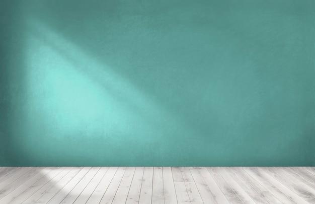 Mur vert dans une pièce vide avec un plancher en bois Photo Premium