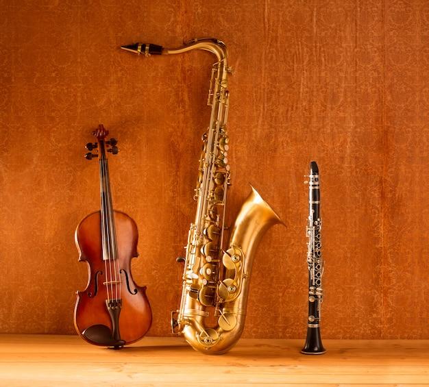 Musique classique saxophone ténor saxophone violon et clarinette vintage Photo Premium