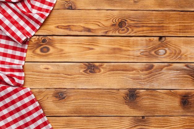 Nappe à carreaux sur fond de table en bois Photo Premium
