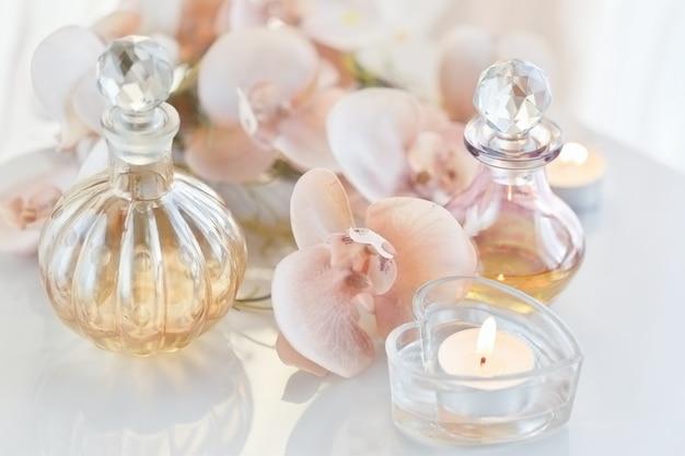 Nature morte de spa avec des bouteilles de parfum et d'huiles aromatiques entourées de fleurs et de bougies Photo Premium