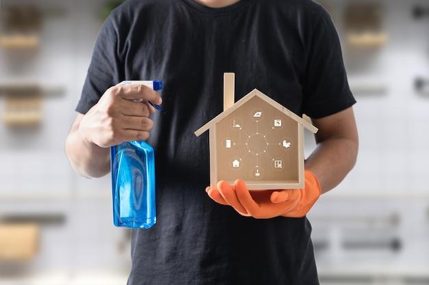 Le nettoyeur professionnel montre le logo de nettoyage Photo Premium